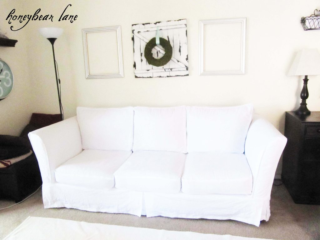 Beige Couch In Family Room With Nvy Blue Area Rug
