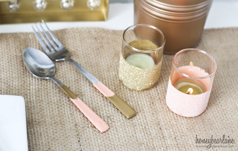 gold and peach silverware and candle holders