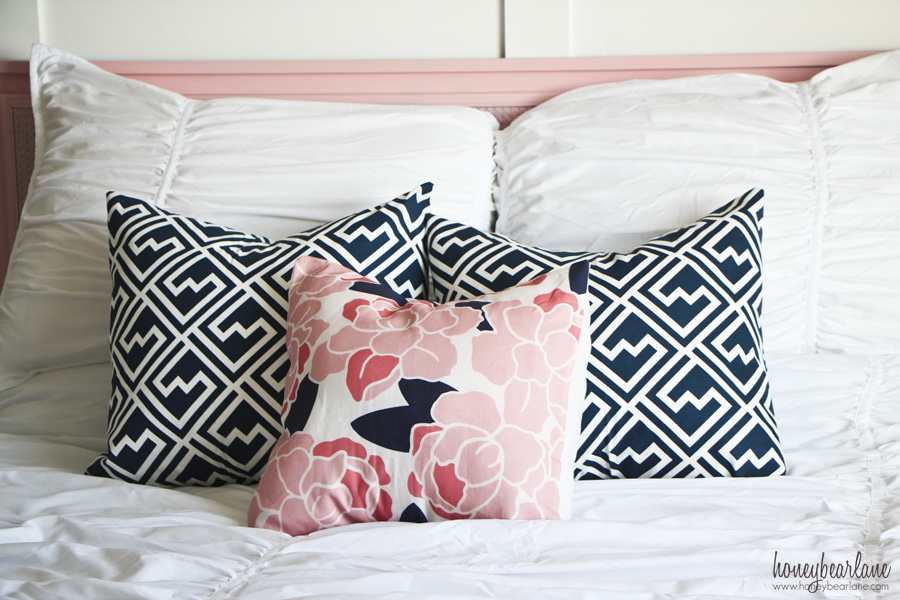 navy blue and pink pillows