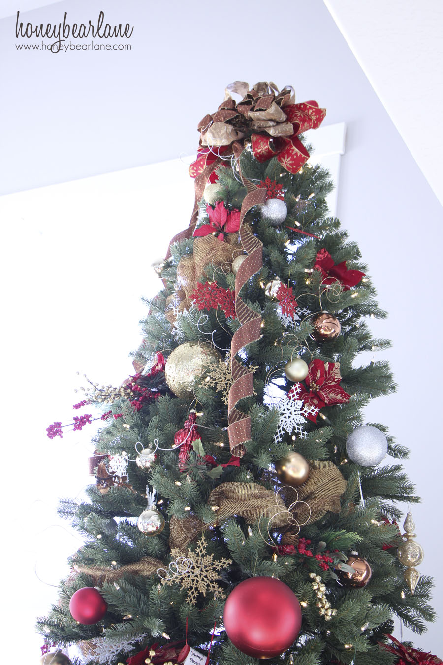 big bow tree topper - How To Decorate A Big Christmas Tree