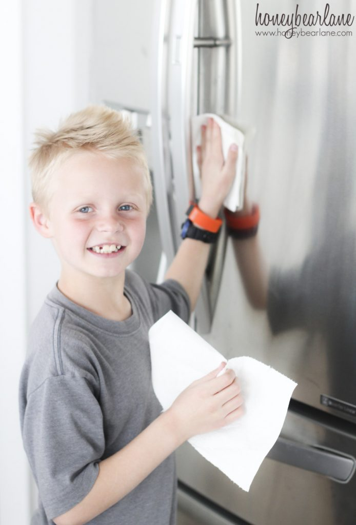 boy cleaning fridge