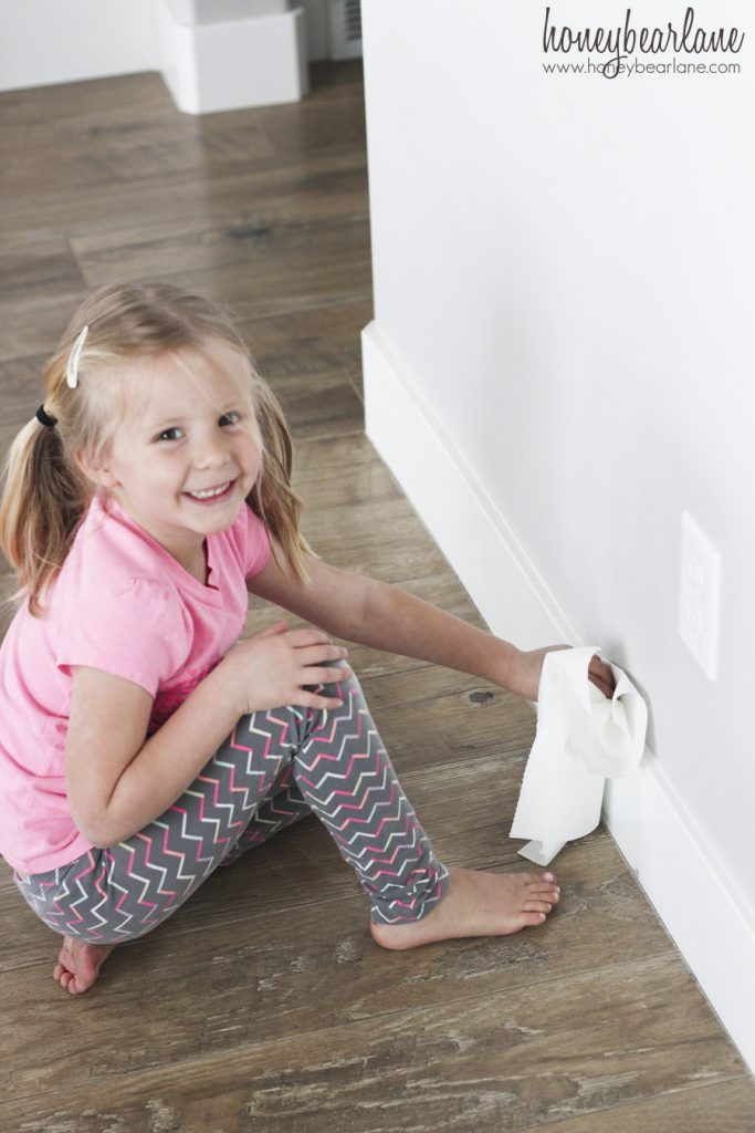 girl cleaning baseboards